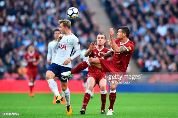 Tottenham Hotspur's Danish midfielder Christian Eriksen vies with Liverpool's English midfielder Jordan Henderson and Liverpool's Croatian defender...