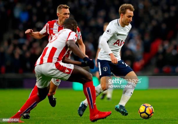 Tottenham Hotspur's Danish midfielder Christian Eriksen vies with Stoke City's Scottish midfielder Darren Fletcher and Stoke City's French defender...