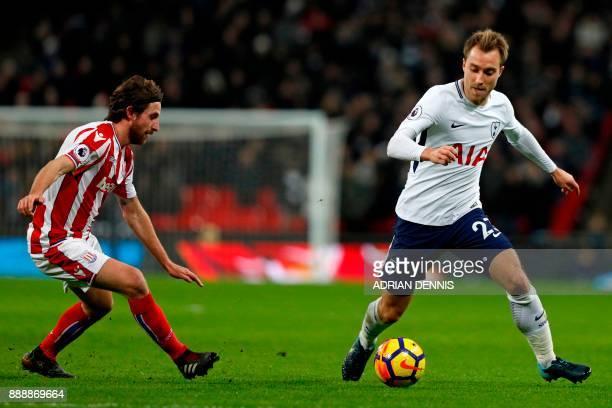 Tottenham Hotspur's Danish midfielder Christian Eriksen vies with Stoke City's Welsh midfielder Joe Allen during the English Premier League football...