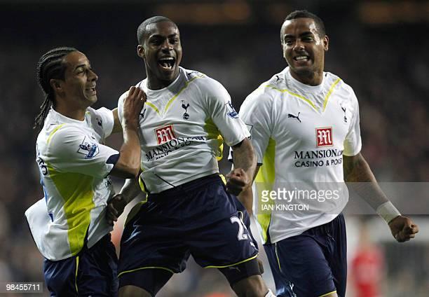 Tottenham Hotspurs Danny Rose celebrates scoring his goal against Arsenal with Tottenham Hotspurs Cameroon player Benoit AssouEkotto and Tottenham...