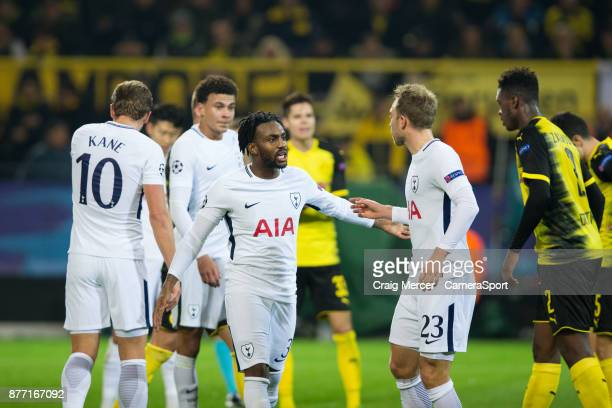 Tottenham Hotspur's Danny Rose talks to team mate Christian Eriksen during the UEFA Champions League group H match between Borussia Dortmund and...