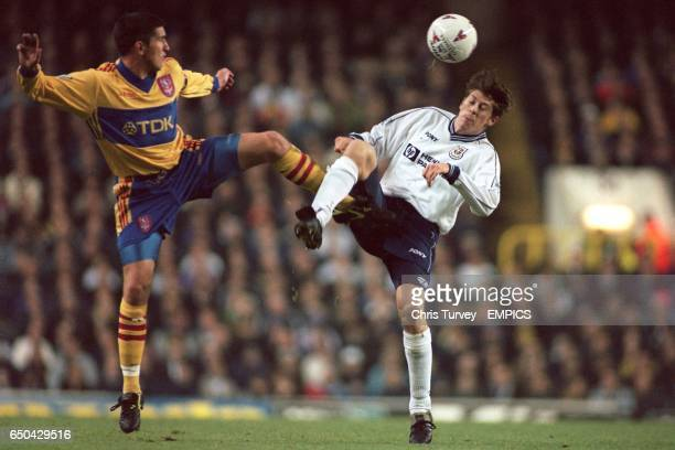 Tottenham Hotspur's Darren Anderton is beaten to the ball by Crystal Palace's Andy Roberts