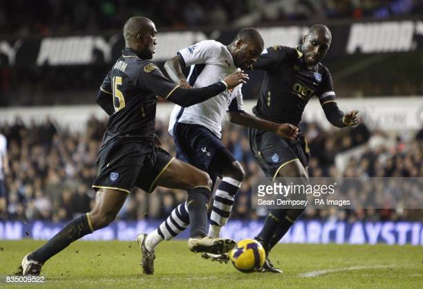 Tottenham Hotspur's Darren Bent battles for the ball with Portsmouth's Sol Campbell and Sylvain Distin