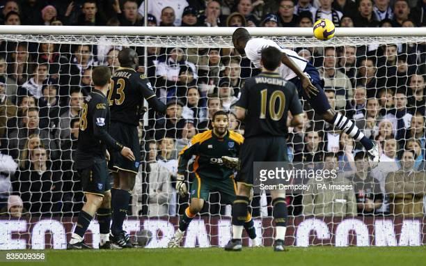 Tottenham Hotspur's Darren Bent has a shot on goal