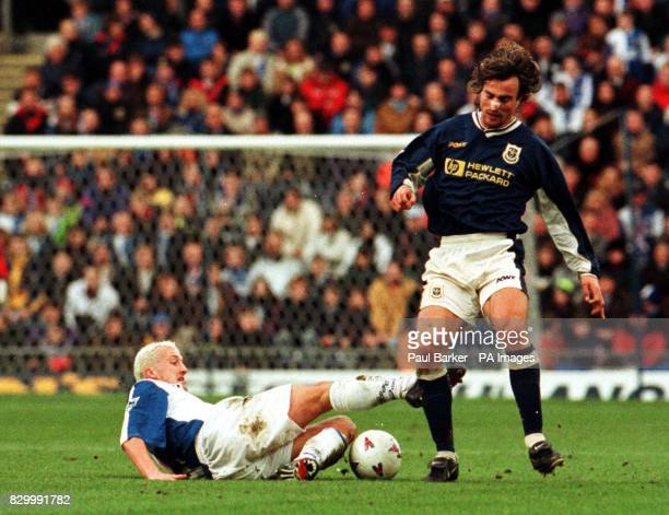 Tottenham Hotspur's David Ginola in midfield action with Blackburn Rovers Billy McKinlay during this afternoon's Premiership clash at Ewood Park...