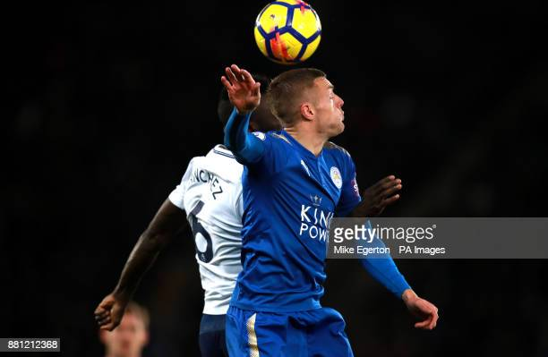 Tottenham Hotspur's Davinson Sanchez and Leicester City's Jamie Vardy battle for the ball during the Premier League match at the King Power Stadium...