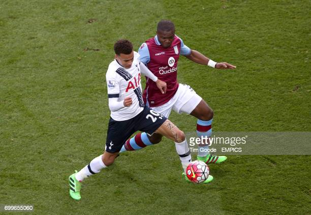 Tottenham Hotspur's Dele Alli and Aston Villa's Jores Okore battle for the ball