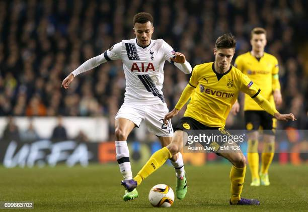 Tottenham Hotspur's Dele Alli and Dortmund's Julian Weigl battle for the ball