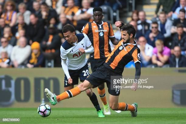 Tottenham Hotspur's Dele Alli and Hull City's Andrea Ranocchia battle for the ball during the Premier League match at the KCOM Stadium Hull