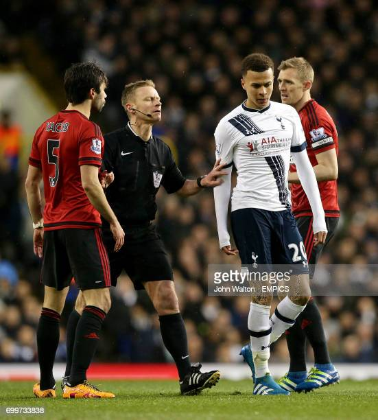 Tottenham Hotspur's Dele Alli argues with West Bromwich Albion's Claudio Yacob as referee Mike Jones controls the situation