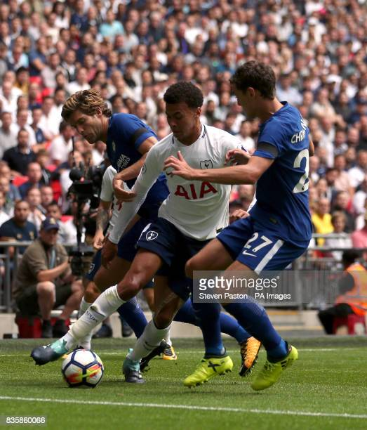 Tottenham Hotspur's Dele Alli battles for the ball with Chelsea's Marcos Alonso and Andreas Christensen during the Premier League match at Wembley...