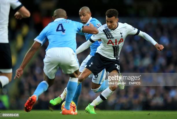 Tottenham Hotspur's Dele Alli battles with Manchester City's Fernando and Vincent Kompany