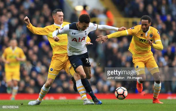 Tottenham Hotspur's Dele Alli in action with Millwall's Shaun Williams and Shaun Cummings during the Emirates FA Cup Quarter Final match at White...