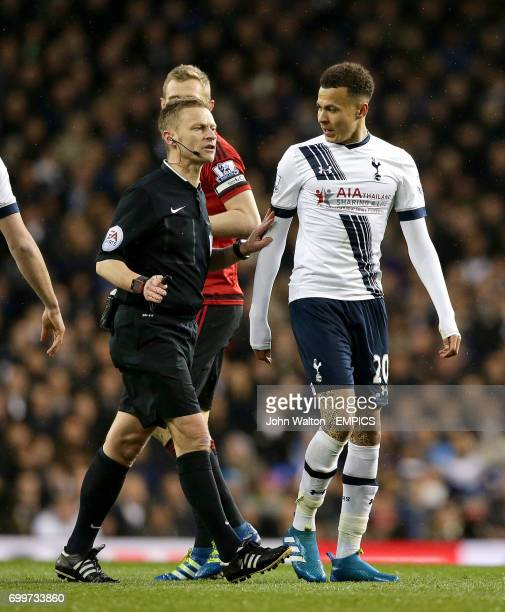 Tottenham Hotspur's Dele Alli speaks with referee Mike Jones after a clash with West Bromwich Albion's Claudio Yacob
