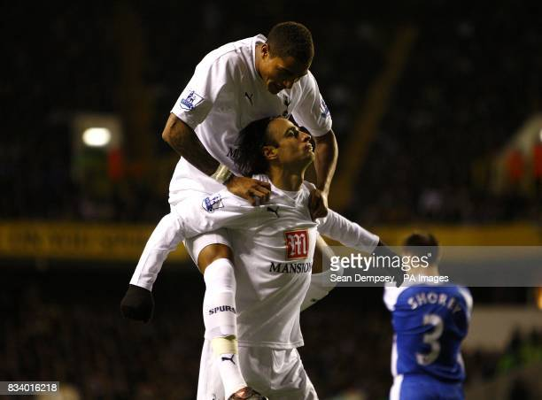Tottenham Hotspur's Dimitar Berbatov celebrates scoring his fourth goal of the game to make it 64 with teammate KevinPrince Boateng