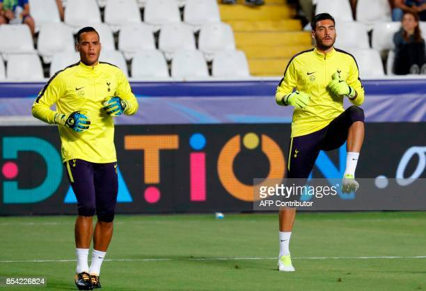 Tottenham Hotspur's Dutch goalkeeper Michel Vorm and Argentine goalkeeper Paulo Gazzaniga warmup ahead of the UEFA Champions League football match...