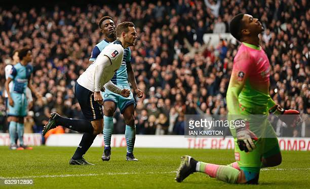 Tottenham Hotspur's Dutch striker Vincent Janssen celebrates scoring his team's second goal from the penalty spot during the English FA Cup fourth...