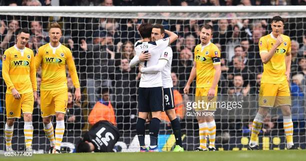 Tottenham Hotspur's Dutch striker Vincent Janssen celebrates scoring his team's fifth goal with Tottenham Hotspur's South Korean striker Son HeungMin...