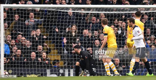 Tottenham Hotspur's Dutch striker Vincent Janssen celebrates scoring his team's fifth goal during the English FA Cup quarterfinal football match...