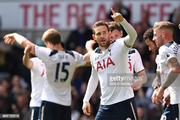Tottenham Hotspur's Dutch striker Vincent Janssen celebrates with teammates after scoring their fourth goal during the English Premier League...