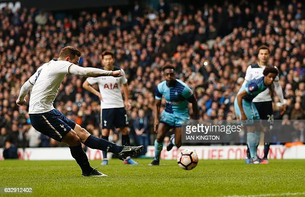 Tottenham Hotspur's Dutch striker Vincent Janssen shoots from the penalty spot to score his team's second goal during the English FA Cup fourth round...