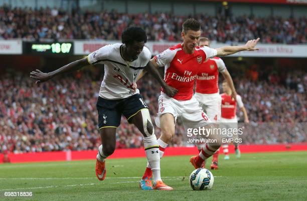 Tottenham Hotspur's Emmanuel Adebayor battles for possession of the ball with Arsenal's Laurent Koscielny