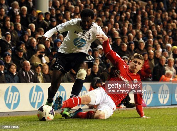 Tottenham Hotspur's Emmenuel Adebayor and Cardiff City's Declan John battle for the ball during the Barclays Premier League match at White Hart Lane...