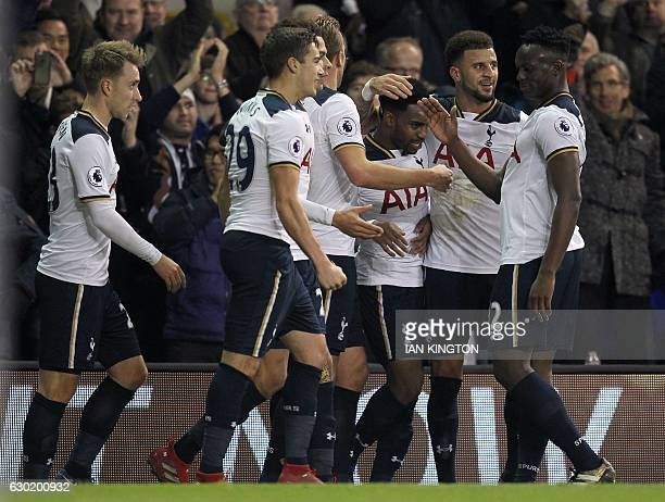 Tottenham Hotspur's English defender Danny Rose is congratulated by teammates after scoring his team's second goal during the English Premier League...