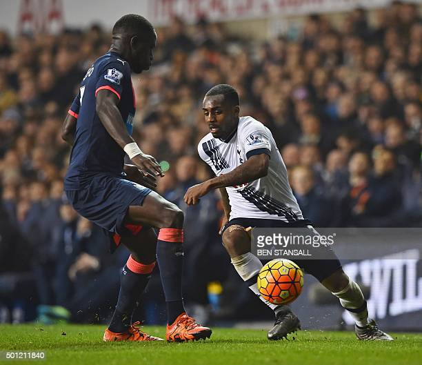 Tottenham Hotspur's English defender Danny Rose plays the ball away from Newcastle United's French midfielder Moussa Sissoko during the English...