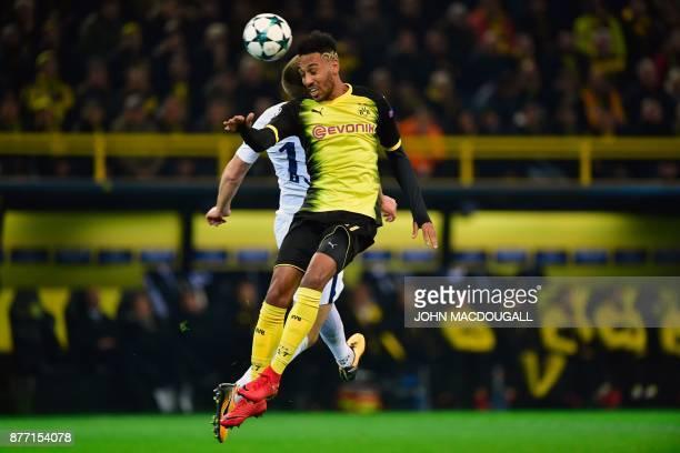 TOPSHOT Tottenham Hotspur's English defender Eric Dier and Dortmund's Gabonese forward PierreEmerick Aubameyang vie for the ball during the UEFA...