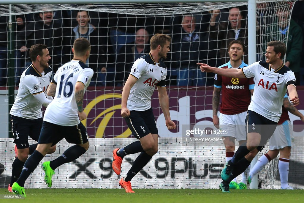 Tottenham Hotspur's English defender Eric Dier (C) celebrates with teammates after scoring the opening goal of the English Premier League football match between Burnley and Tottenham Hotspur at Turf Moor in Burnley, north west England on April 1, 2017. / AFP PHOTO / Lindsey PARNABY / RESTRICTED TO EDITORIAL USE. No use with unauthorized audio, video, data, fixture lists, club/league logos or 'live' services. Online in-match use limited to 75 images, no video emulation. No use in betting, games or single club/league/player publications. /