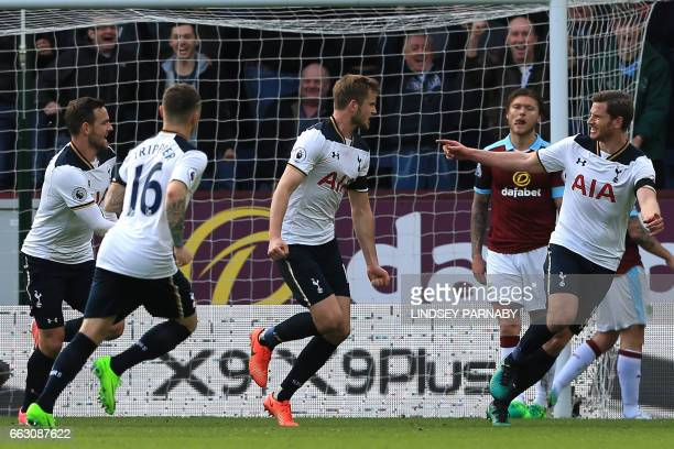 Tottenham Hotspur's English defender Eric Dier celebrates with teammates after scoring the opening goal of the English Premier League football match...