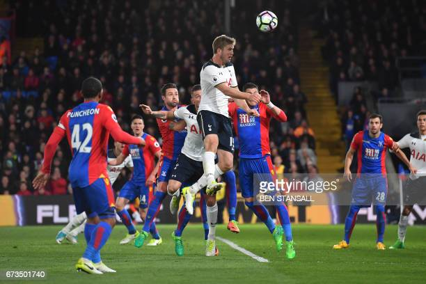 Tottenham Hotspur's English defender Eric Dier heads the ball from across but misses the goal during the English Premier League football match...