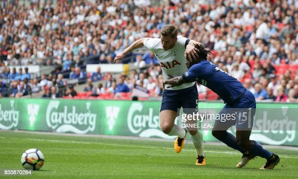 Tottenham Hotspur's English defender Eric Dier tangles with Chelsea's Nigerian midfielder Victor Moses during the English Premier League football...