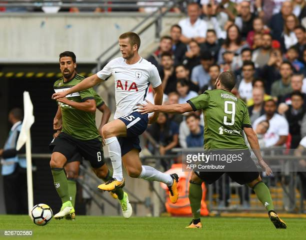 Tottenham Hotspur's English defender Eric Dier vies with Juventus' German midfielder Dami Khedira and Juventus' Argentinian striker Gonzalo Higuain...