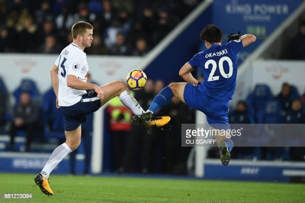 Tottenham Hotspur's English defender Eric Dier vies with Leicester City's Japanese striker Shinji Okazaki during the English Premier League football...