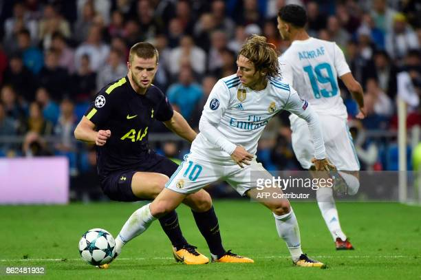 Tottenham Hotspur's English defender Eric Dier vies wth Real Madrid's Croatian midfielder Luka Modric during the UEFA Champions League group H...