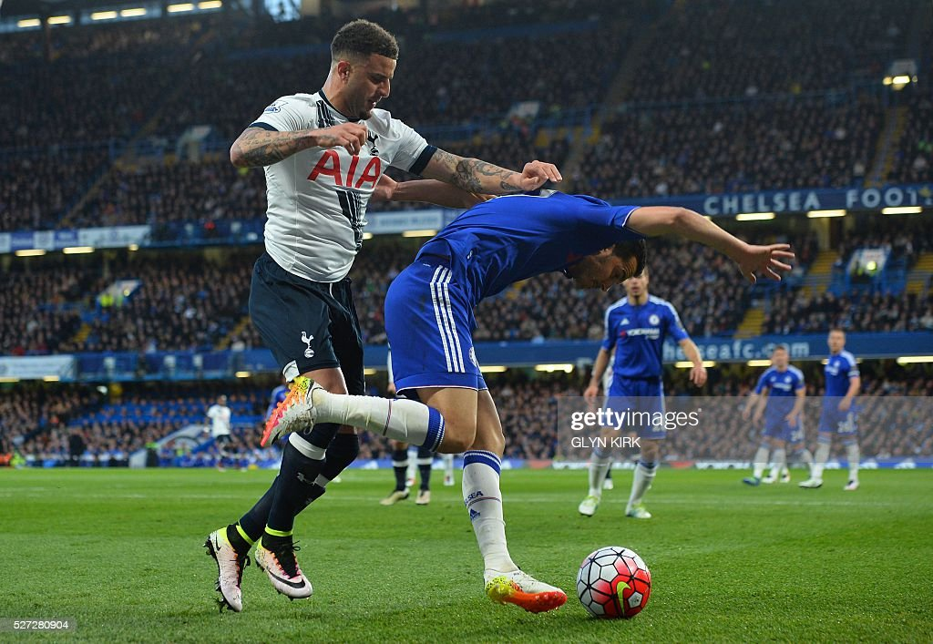 Tottenham Hotspur's English defender Kyle Walker (L) bundles over Chelsea's Spanish midfielder Pedro (R) to concede a foul during the English Premier League football match between Chelsea and Tottenham Hotspur at Stamford Bridge in London on May 2, 2016. / AFP / GLYN KIRK / RESTRICTED TO EDITORIAL USE. No use with unauthorized audio, video, data, fixture lists, club/league logos or 'live' services. Online in-match use limited to 75 images, no video emulation. No use in betting, games or single club/league/player publications. /