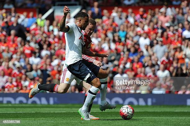 Tottenham Hotspur's English defender Kyle Walker takes the ball from Manchester United's English striker Wayne Rooney but can only divert the ball...