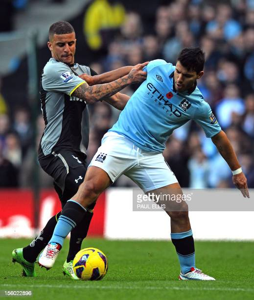 Tottenham Hotspur's English defender Kyle Walker vies with Manchester City's Argentinian striker Sergio Aguero during the English Premier League...
