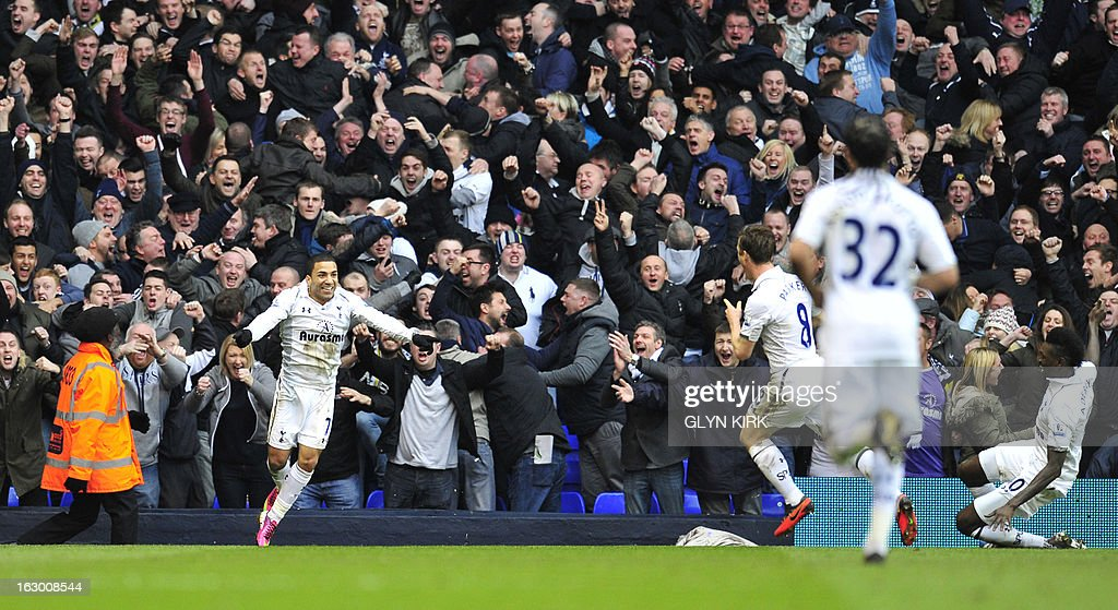 """Tottenham Hotspur's English midfielder Aaron Lennon (L) celebrates scoring their second goal with teammates during the English Premier League football match between Tottenham Hotspur and Arsenal at White Hart Lane in north London on March 3, 2013. USE. No use with unauthorized audio, video, data, fixture lists, club/league logos or """"live"""" services. Online in-match use limited to 45 images, no video emulation. No use in betting, games or single club/league/player publications"""