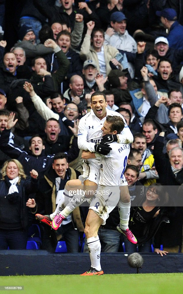 """Tottenham Hotspur's English midfielder Aaron Lennon (L) celebrates scoring their second goal with English midfielder Scott Parker (R) during the English Premier League football match between Tottenham Hotspur and Arsenal at White Hart Lane in north London on March 3, 2013. USE. No use with unauthorized audio, video, data, fixture lists, club/league logos or """"live"""" services. Online in-match use limited to 45 images, no video emulation. No use in betting, games or single club/league/player publications"""