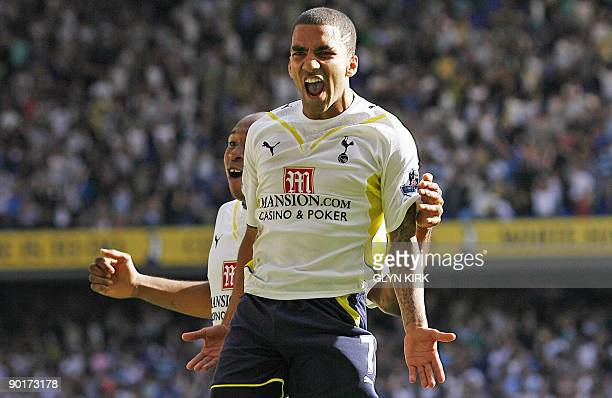 Tottenham Hotspur's English midfielder Aaron Lennon celebrates scoring the late winner during the English Premier League football match between...