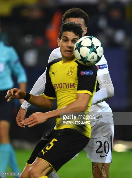 Tottenham Hotspur's English midfielder Dele Alli and Dortmund's Spanish defender Marc Bartra vie for the ball during the UEFA Champions League Group...