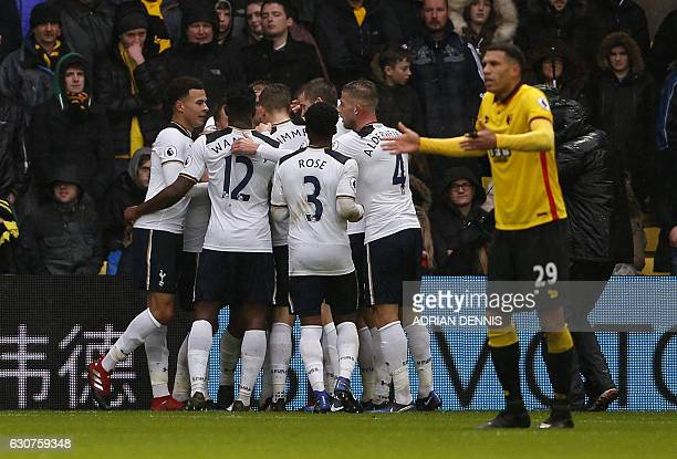 Tottenham Hotspur's English midfielder Dele Alli and teammates mob Tottenham Hotspur's English striker Harry Kane after he scores his team's first...