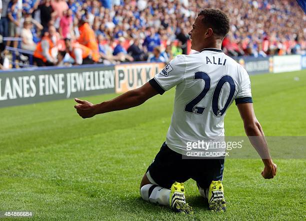 Tottenham Hotspur's English midfielder Dele Alli celebrates scoring the opening goal of the English Premier League football match between Leicester...