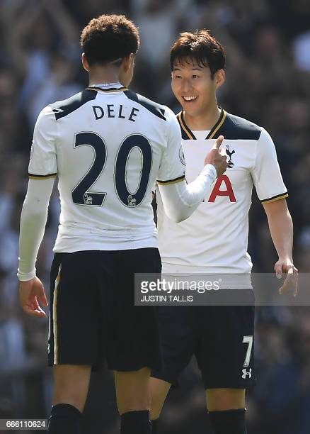 Tottenham Hotspur's English midfielder Dele Alli celebrates scoring his team's first goal with Tottenham Hotspur's South Korean striker Son HeungMin...