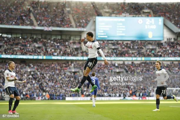 Tottenham Hotspur's English midfielder Dele Alli celebrates scoring the team's second goal with Tottenham Hotspur's Belgian defender Toby...