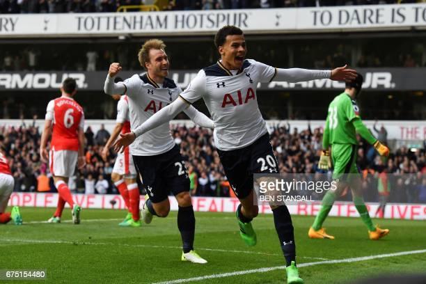Tottenham Hotspur's English midfielder Dele Alli celebrates scoring the opening goal with Tottenham Hotspur's Danish midfielder Christian Eriksen...