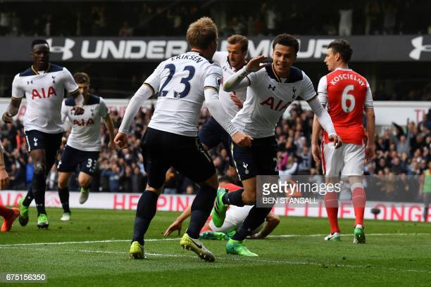 Tottenham Hotspur's English midfielder Dele Alli celebrates scoring the opening goal with Tottenham Hotspur's Danish midfielder Christian Eriksen...